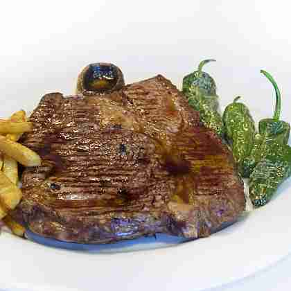 Grilled Sayago T-Bone steak accompanied with side dish